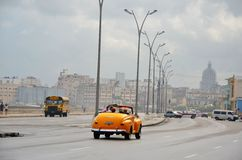 Malecon in Havana with American car, Cuba. Malecon in Havana and typical American car, Cuba Royalty Free Stock Images