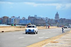 Malecon in Havana with American car, Cuba. Malecon in Havana and typical American car, Cuba Stock Images