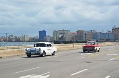 Malecon in Havana with American cars, Cuba Stock Photos