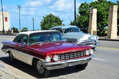 Malecon in Havana with American cars, Cuba Royalty Free Stock Photo