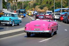 Malecon in Havana with American cars, Cuba Stock Photo