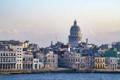 Malecon Havana with colonial buildings and Capitolio, Cuba, seen from seaside. Old Havana - Havana Vieja - with colorful colonial buildings and Capitol in Royalty Free Stock Photography