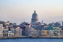 Malecon Havana with colonial buildings and Capitolio, Cuba, seen from seaside. Old Havana - Havana Vieja - with colorful colonial buildings and Capitol in Stock Photography