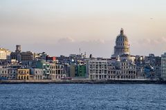 Malecon Havana with colonial buildings and Capitolio, Cuba, seen from seaside. Old Havana - Havana Vieja - with colorful colonial buildings and Capitol in Stock Image