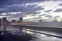Malecon - Havana, Cuba. Evening at the seaside drive Malecon in Havana, Cuba as the waves crash over Stock Images