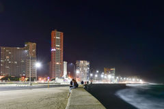 Malecon - Havana, Cuba. The Malecon officially Avenida de Maceo in Havana at night. It is a broad esplanade, roadway and seawall which stretches for 8 km 5 miles Royalty Free Stock Photo