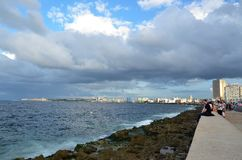 Malecon in Havana, Cuba. Malecon in Havana with tourists, along coast promenade, Cuba Stock Photo