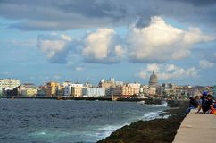 Malecon in Havana with tourists, Cuba. Malecon in Havana with Copula Capitolio Cuban White house, Cuba Royalty Free Stock Photos