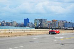 Malecon in Havana with typical american car, Cuba. Malecon in Havana and typical american car, Cuba Royalty Free Stock Photo