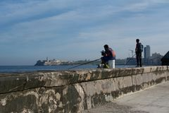 Malecon. Malecon is the name of the coast in Havana, Cuba. It is frequented by young men trying to catch their dinner stock photography