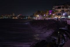 Malecon. A night shot at the waters edge of the malecon in Puerto Vallarta Royalty Free Stock Photos