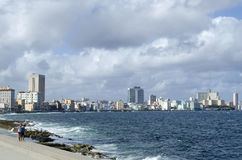 Malecon promenade, famous place in Havana. Two boys enjoy the sunny weather and walking on the breakwater in Havana's Malecon promenade on 29 November 2015 in Royalty Free Stock Images