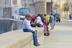 Malecon promenade and People in Havana, Cuba, Caribbean Royalty Free Stock Photography