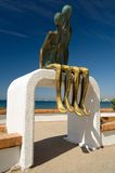 Malecon Statue. One of the many statues located along the Malecon in Puerto Vallarta Stock Photo