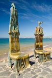 Malecon Statues. A pair of the many unique statues situated along the Malecon in Puerto Vallarta, Mexico Stock Image