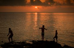 Malecon Sunset. Three boys at sunset on the Malecon Havana Royalty Free Stock Images