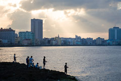 Malecon at sunset, Havana. The Malecon or waterfront with skyline of the city of Havana in Cuba Royalty Free Stock Image