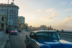 Malecon typical view in sunset with La Havana buildings and cars. La Havana, Cuba December 25, 2016 Malecon typical view in sunset with La Havana buildings at Stock Photography