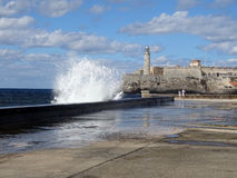 Malecon Under Waves. A wave submerges the walk along the Malecon, Havana, Cuba Royalty Free Stock Images