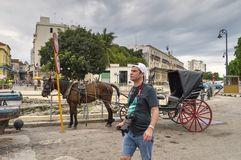 At the Malecon waterfront. Cuba, Havana 12-05-2015, area of the Malecon waterfront, horses harnessed in a wagon, in the historical center of the city Royalty Free Stock Images