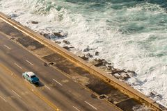 Malecon waves in Havana, Cuba. Classic car Royalty Free Stock Photography