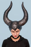 Maleficent  - beautiful woman from a fairytale with hair horns and creative make-up for the Halloween party.  Royalty Free Stock Photography