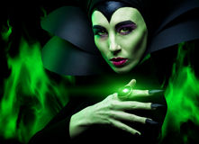 Maleficent demonic - starring. Awesome woman holding a magic ball Stock Photo