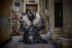Maleficent. Masked models  of the Venetian Carnevale Stock Photos
