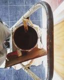 Malen auf einer Leiter stockfoto