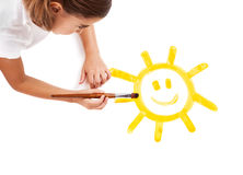 Malen einer glücklichen Sonne lizenzfreies stockbild