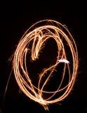 Malen eines Herzens mit Licht stockbilder