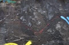 Malen Sie befleckte schwarze Wand Lizenzfreie Stockbilder
