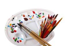 Malen Sie Palette und Bürsten Stockfotografie