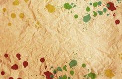 Malen Sie Splatters auf braunem Papier Lizenzfreies Stockfoto