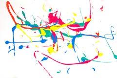 Malen Sie Stellen, Farbentropfen, Farbe auf einem weißen Hintergrund Stockfotografie