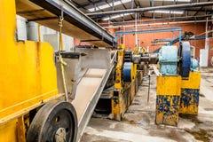 Malende fabrieksmachines Stock Foto's