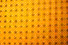 Malendes orange Hintergrundmaschenmuster Stockbilder