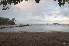 Malendure beach in Guadeloupe, Caribbean. Early morning and sunrise at Malendure beach in Guadeloupe, Caribbean. Place famous for its dark sand and great diving Royalty Free Stock Photo