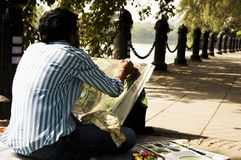 Maler auf dem Bürgersteig Stockfoto