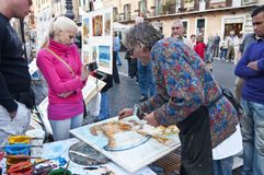 Maler, der an Marktplatz Navona, Rom arbeitet Lizenzfreie Stockfotografie