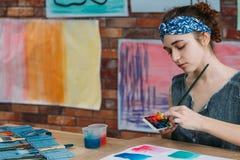 Maler-Zusammenfassungsgrafiken der Inspiration linkshändige lizenzfreies stockbild