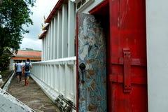 Malerei der alten asiatischen, thailändischen Malerei auf einer Tür bei Wat Phra Chetuphon am Ort bekannt als Wat Pho Stockfotografie