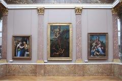 Malerei von Raphael Santi-` Erzengel Michael und das Teufel ` 1518 und andere Malereien in der Halle Luftschlitz lizenzfreies stockfoto