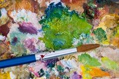 Malerpinsel und Palette Stockfotografie