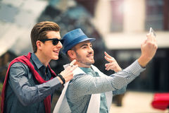 Males beautiful models outdoors make selfie photos. City style fashion Royalty Free Stock Image
