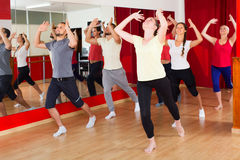 Males and females dancing. Happy males and females smiling and dancing contemp dance in studio Stock Images