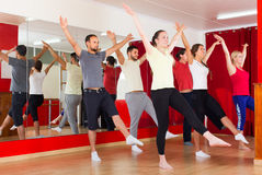 Males and females dancing. Happy young males and females smiling and dancing contemp dance in studio Stock Photo