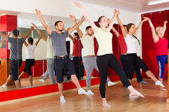 Males and females dancing. Males and females smiling and dancing contemp dance in studio Stock Images