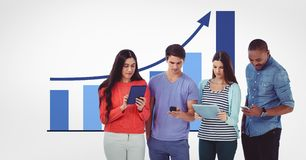 Males and females using technologies against graph. Digital composite of Males and females using technologies against graph Royalty Free Stock Image