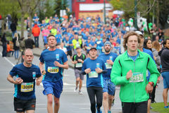 Males Runners Competing in Vancouver Sun Run 2017. Stress and strain is etched on athletes` faces as  about 40,000 runners competed in 2017 Vancouver Sun Run in Royalty Free Stock Photos